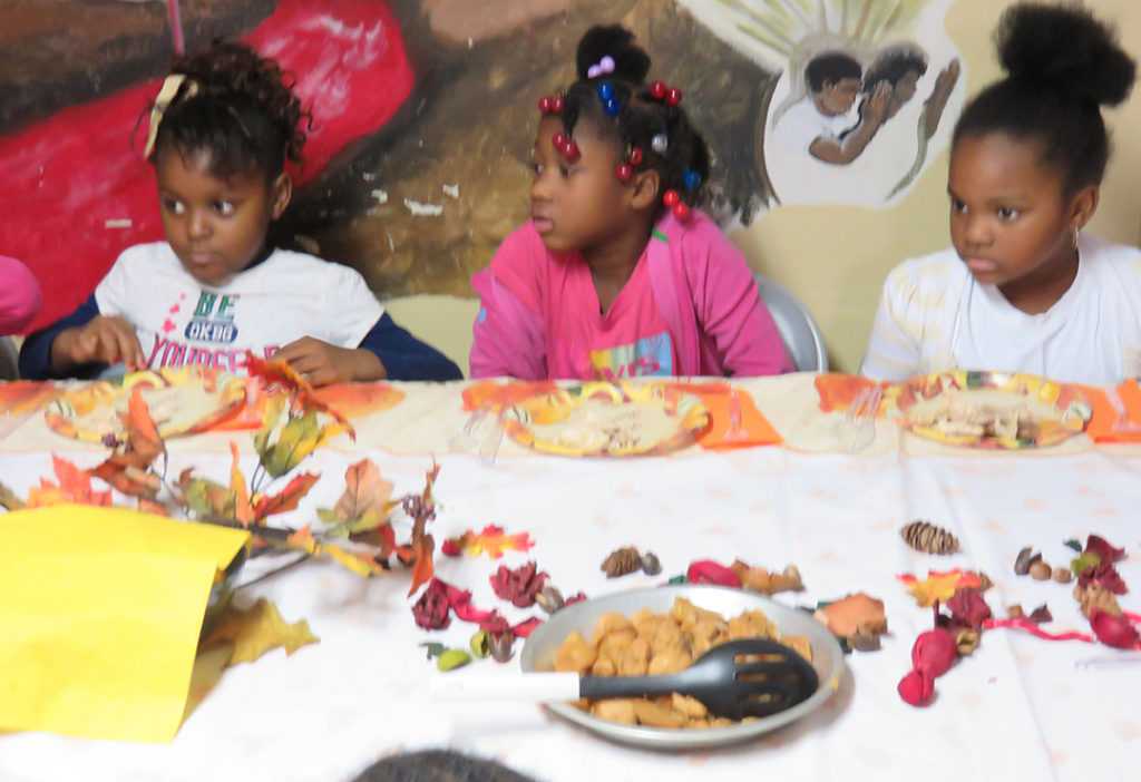 Children who are enjoying their Thanksgiving meal