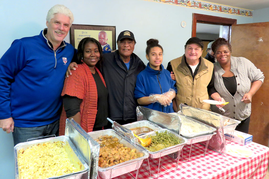 Jeff Nixon, Booker Edgerson, Lou Piccone with staff who cooked and served a great thanksgiving meal