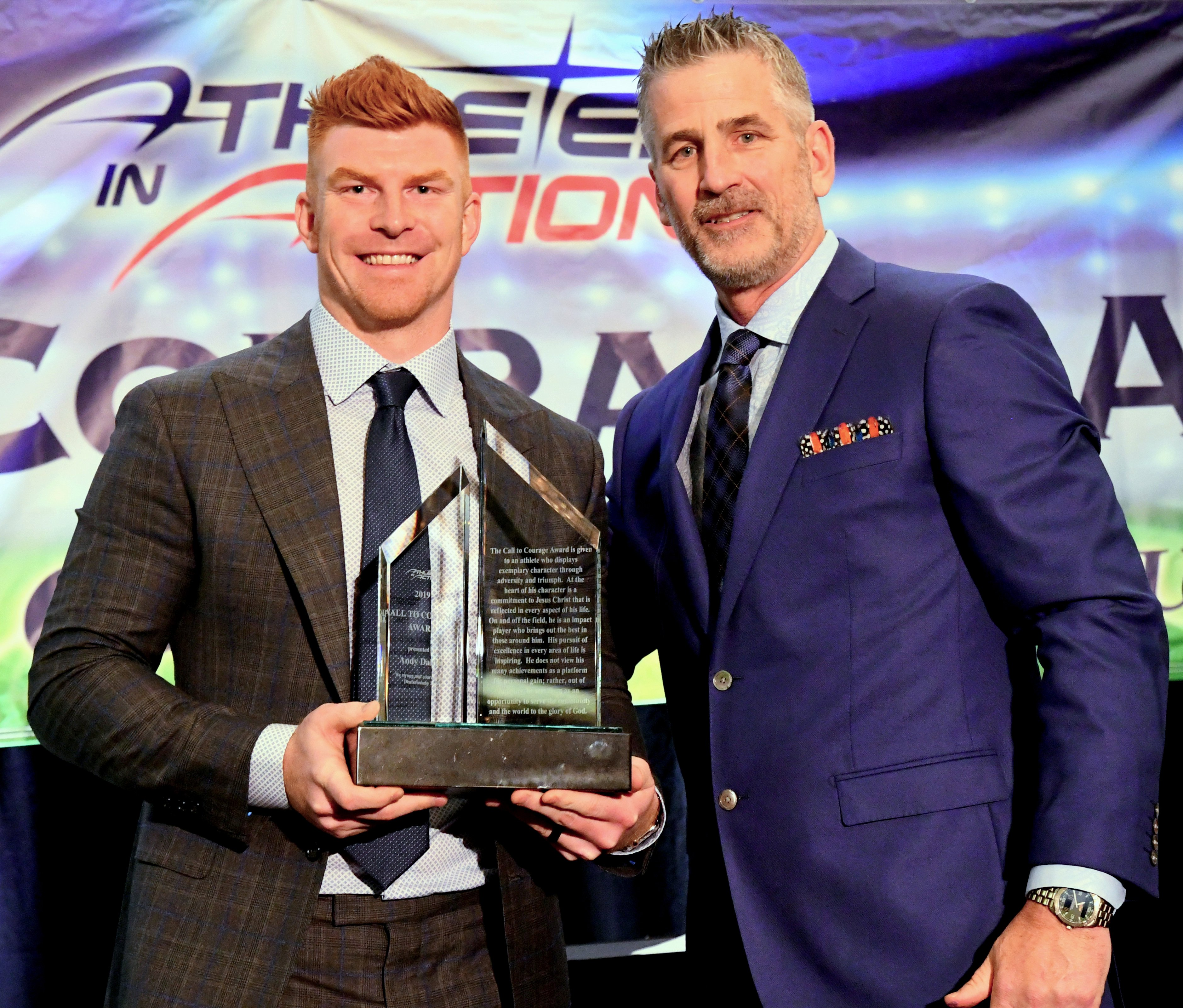 Buffalo Bills Alumni & Head Coach of the Indianapolis Colts Frank Reich presents the 2019 Call to Courage Award to Cincinnati Bengals QB Andy Dalton